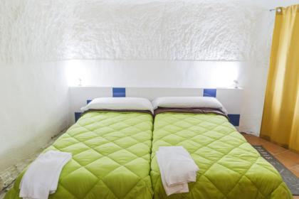 Dormitorio de la casa cueva el alcaraván